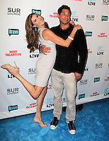 Heather McDonald, Joe Francis.Bravo's Andy Cohen's Book Release Party For &quot;Most Talkative: Stories From The Front Lines Of Pop Held at SUR Lounge, West Hollywood, California, USA..May 14th, 2012.full length grey gray jeans denim black jacket dress side arm around waist hug embrace leg foot up .CAP/ADM/KB.&copy;Kevan Brooks/AdMedia/Capital Pictures.