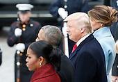 United States President Donald Trump stands with former President of the United States Barack Obama and former First lady Michelle Obama as they stand on the east front steps of the Capitol Building after Trump is sworn in at the 58th Presidential Inauguration on Capitol Hill in Washington, D.C. on January 20, 2017.  <br /> Credit: John Angelillo / Pool via CNP