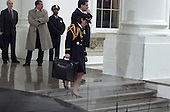 "Washington, DC - January 20, 2001 -- An unidentified United States Army officer carries the briefcase, called the ""football"", containing the nuclear launch codes, out of the White House on Inauguration Day..Credit: Ron Sachs / CNP"