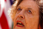 Roberta Allen wears flag colored contact lenses as she and others protest the visit of Mexican President Vicente Fox outside the State Capitol, Thursday May 25 2006..Sacramento Bee/  Brian Baer