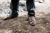 Felipe de Jesus Rios sandals at Felix Garcia´s ranch and distillery in El Potrero, Oaxaca, Oaxaca, Mexico