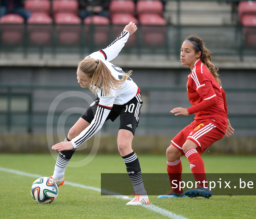 20151128 - Tubize , Belgium : Belgian Anais Bey Tem Samani (R) and German Laura Haas (L) pictured during the female soccer match between Women under 16 teams of  Belgium and Germany , in Tubize . Saturday 28th November 2015 . PHOTO DIRK VUYLSTEKE