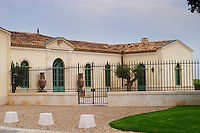 The newly renovated Chateau Petrus with iron fence and gate Pomerol Bordeaux Gironde Aquitaine France