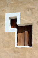 This unusual double window has been restored and painted in the traditional manner