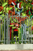 Egypt's Afroto gets a celebratory hug from fans through the fence after making the first goal of the FIFA Under 20 World Cup Group A Match against Trinidad & Tobago at the Egyptian Army Stadium on September 24, 2009 in Alexandria, Egypt.