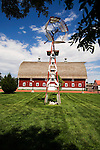 Oldtown Museum in Burlington, Colorado--wooden vainless windmill; red barn with weather vanes on cupolas