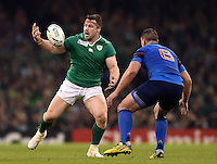 Cian Healy of Ireland looks to gather the ball. Rugby World Cup Pool D match between France and Ireland on October 11, 2015 at the Millennium Stadium in Cardiff, Wales. Photo by: Patrick Khachfe / Onside Images