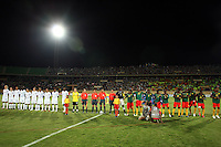The United States' under 20 soccer team stands beside the Cameroon under 20 soccer team before the game against Cameroon before the FIFA Under 20 World Cup Group C Match at the Mubarak Stadium on September 29, 2009 in Suez, Egypt.