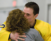 Ryan Kayfes (Bentley - 12) gives his mom a kiss. - The Bentley University Falcons tied the visiting College of the Holy Cross Crusaders 2-2 on Bentley senior night on Friday, February 24, 2012, at the John A. Ryan Skating Arena in Watertown, Massachusetts.