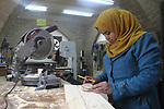 Ghadir Tayeh, 26, a Palestinian woman works at a carpentry in Beit Lahia in the northern Gaza strip on Feb. 14, 2017. Tayeh works on carpentry alongside with another 8 woman to help their husbands as the Israeli blockade of the Gaza Strip continues. They produced more than 1,700 wooden toys and they sold it 3-8$ per one. Photo by Mohammad Sallam