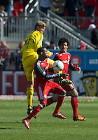 31 March 2011: Columbus Crew forward Aaron Schoenfeld #34 and Toronto FC defender Ashtone Morgan #5 in action during a game between the Columbus Crew and the Toronto FC at BMO Field in Toronto, Ontario Canada..The Columbus Crew won 1-0.