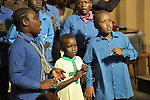 A children's choir sings during a worship service of Nuer refugees from South Sudan who live in Cairo, Egypt. The service took place at St Andrews United Church of Cairo.