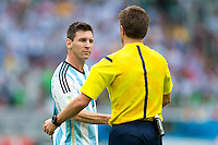 Lionel Messi of Argentina shakes hands and winks at referee Nicola Rizzoli