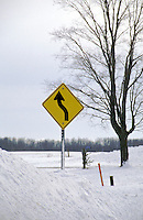 Road Sign Buried in Snowbank