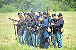 Old Bethpage, New York, USA - July 21, 2012: Troops clean the barrels of their muskets between rounds of shots, at Camp Scott, a Union Army training camp, as portrayed by Federal Re-enactors at Old Bethpage Village Restoration, to commemorate 150th Anniversary of American Civil War.