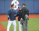North Carolina-Wilmington pitching coach Jason Howell (left), who was ejected, and head coach Mark Scalf (center) argue with home plate umpire Steve Dew at Oxford-University Stadium in Oxford, Miss. on Saturday, February 25, 2012. Ole Miss won 6-4.