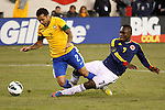 Colombian player Pablo Armero (R ) fights for the ball with Brazilian player Daniel Alves during their friendly match at MetLife Stadium in East Rutherford New Jersey, November 14, 2012. Photo by Eduardo Munoz Alvarez / VIEWpress.