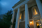 Storm clouds brew over the Lilly Library on East Campus at dusk.