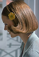 Model with bobbed hairstyle and flower hair pin, 1975. Photo by John G. Zimmerman