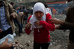 A young woman reacts to the effects of tear gas on Mohamed Mahmoud Streetl near Tahrir Square in Cairo, Egypt, Tuesday, November 22, 2011. Clashes between Central Security Forces and demonstrators demanding an end to military rule continued into a fourth day.
