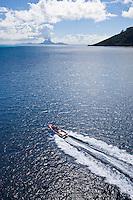 Local poti marara, a fishing speedboat, off Bora Bora, Tahiti