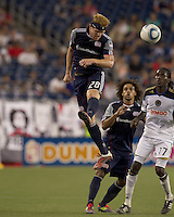 New England Revolution midfielder Pat Phelan (28) heads the ball. In a Major League Soccer (MLS) match, the Philadelphia Union defeated the New England Revolution, 3-0, at Gillette Stadium on July 17, 2011.