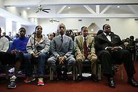 New York, USA. 23 August 2014. Esaw Garner wife of Eric Garner, (2nd L) and Rev. Al Sharpton (C ) attend a mass before a rally against police brutality in Staten Island.  Eduardo Munoz Alvarez/VIEWpress