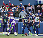 Seattle Seahawks running back Marshawn Lynch celebrates a touchdown against the  Minnesota Vikings at CenturyLink Field in Seattle, Washington on  November 17, 2013.  Lynch ran for 54 yards and scored two touchdowns in Seahawks 41-20 win over the Vikings.  ©2013.  Jim Bryant. All Rights Reserved.
