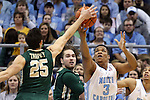 30 December 2014: North Carolina's Kennedy Meeks (3) and William and Mary's Terry Tarpey (25) challenge for the ball. The University of North Carolina Tar Heels played the College of William & Mary Tribe in an NCAA Division I Men's basketball game at the Dean E. Smith Center in Chapel Hill, North Carolina. UNC won the game 86-64.
