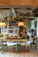 The dining table in this country kitchen is covered in an abundance of fresh local produce