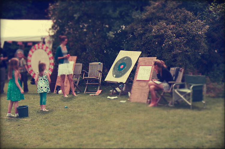 People enjoying a small summer fete in the village of Brome &amp; Oakley in Suffolk, England.