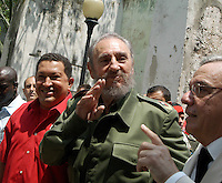 "President of Venezuela Hugo Chavez, (left), the Cuban President Fidel Castro, and Historia Eusebio Leal, greet when arriving at the ""Simon Bolivar´sHouse"" to inaugurate the offices of PDVESA, April 28, 2005. I castrate joined Chavez AT the opening of the South oil American nation's new company office in Cuba ace the leftist leaders to further integrated to their economies and promoted to hemispheric trade pact that would exclude the United States.arrive at the building of the ""Lonja del Comercio"", Havana, Cuba, April 28, 2005. Chavez and Fidel inaugurate a PDVSA office (Petroleos Venezuelan) Credit: Jorge Rey/MediaPunch"