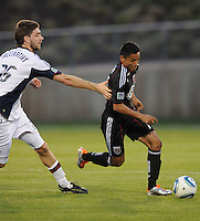 DC United midfielder Andy Najar (14) shields the ball against New England Revolution midfielder Stephen McCarthy (26)  The New England Revolution defeated DC United 3-2 in US Open Cup match , at the Maryland SoccerPlex, Tuesday  April 26, 2011.