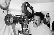 June 1969 --- Melvin Van Peebles checks a shot on the set of his 1970 film, Watermelon Man. --- Image by © JP Laffont