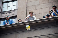 Gabe Kooreman, age 20, a senior Chemical Engineering student from The Cooper Union Engineering School tosses his entry in the Annual Egg Drop Competition on March 20, 2012 in New York.  The participants had to design and build a device to securely house a raw egg so that it could survive intact a three story drop from the portico of the school's Foundation building.  (© Frances M. Roberts)