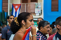 A Cuban girl carries the national flag during the annual celebration of the Cuban Revolution anniversary in Santiago de Cuba, Cuba, 26 July 2008. The Cuban revolution began when the poorly armed Cuban rebels, led by Fidel Castro, attacked the Moncada Barracks in Santiago de Cuba on 26 July 1953. The attack was easily defeated and most of the rebels were captured and later executed by the Batista regime. Although Fidel Castro had been sentenced to 15 years of prison, after less than two years he was released, he went to Mexico and in 1956, back in Cuba again, his guerilla group started a new rebellion.
