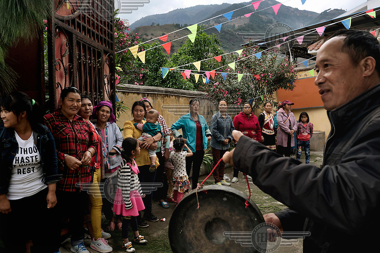 Lisu villagers from Old Xiaoshaba attend an Easter festival at the Xiaoshaba Church. Many Lisu and other ethnic minorities in the Nujiang River valley are Christians having been converted by missionaries in years past.