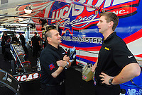 Jan. 17, 2012; Jupiter, FL, USA: NHRA top fuel dragster driver Morgan Lucas (left) and teammate Brandon Bernstein during testing at the PRO Winter Warmup at Palm Beach International Raceway. Mandatory Credit: Mark J. Rebilas-