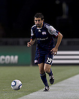 New England Revolution midfielder Monsef Zerka (19) dribbles down the wing. In a Major League Soccer (MLS) match, the Columbus Crew defeated the New England Revolution, 3-0, at Gillette Stadium on October 15, 2011.