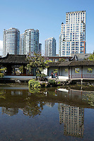 Dr Sun Yat-Sen Chinese Classical Garden with high rise buildings, Chinatown, Vancouver, BC, Canada