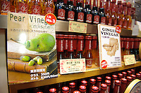 Pear vinegar and ginger vinegar on sale at a Uchibori vinegar shop in Tokyo station, Tokyo, Japan, November 16 2009. Uchibori produces a popular range of drinkable fruit vinegars.