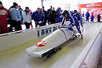 18 December 2010: Alexander Kasjanov pushes his 2-man bobsled for Russia, finishing in 10th place at the Viessmann FIBT World Cup Bobsled Championships on Mount Van Hoevenberg in Lake Placid, New York, USA. Mandatory Credit: Ed Wolfstein Photo