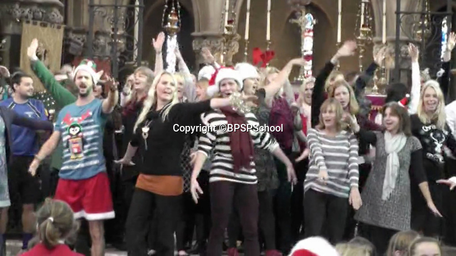 BNPS.co.uk (01202 558833)<br /> Pic: BPSPSchool/BNPS<br /> <br /> All the teachers blast out the popular tune.<br /> <br /> Xmas cheer...<br /> <br /> A heartwarming performance from the hit movie Frozen has delighted primary school children in Poole Dorset - after teachers burst into song during a Xmas service in St Peters church in the town.<br /> <br /> Head teacher Paul Howieson led the staff in the impromptu performance, and even the vicar joined in as the children clapped along.<br /> <br /> Paul said 'The kids have all worked really hard through the year and we thought we would give them a Xmas service to remember.- they certainly seemed to enjoy it'.