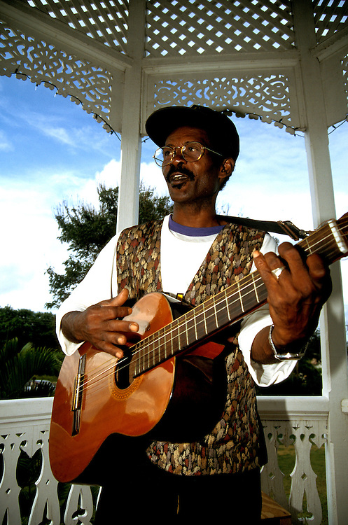 Jamaica: A local musician. photo: jamaic105 .Photo copyright Lee Foster, www.fostertravel.com, 510/549-2202, lee@fostertravel.com