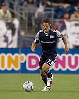 New England Revolution midfielder Ryan Guy (13) brings the ball forward. In a Major League Soccer (MLS) match, the New England Revolution defeated FC Dallas, 2-0, at Gillette Stadium on September 10, 2011.