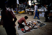 A woman arranges shoes to sell at the small Huastec town that bustles on Sunday for the market. South of Ciudad Valles the road passes through Huasteca Indian country. At one time the Huastec population was once estimated to be one million, but today they number about 150,000 in Mexico.