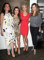 Jenni Pulos, Kyle Richards, Camille Grammer, Rita Wilson.Bravo's Andy Cohen's Book Release Party For &quot;Most Talkative: Stories From The Front Lines Of Pop Held at SUR Lounge, West Hollywood, California, USA..May 14th, 2012.full length white black yellow floral print dress  sleeveless red tiger animal print grey gray top black trousers.CAP/ADM/KB.&copy;Kevan Brooks/AdMedia/Capital Pictures.