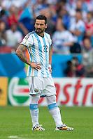 Ezequiel Lavezzi of Argentina looks dejected