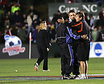14 December 2007: Virginia Tech head coach Oliver Weiss (GER) (r) talks with officials Misail Tsapos (l) and Arkadiusz (Alex) Prus (center) after the game. The Wake Forest University Demon Deacons defeated the Virginia Tech University Hokies 2-0 at SAS Stadium in Cary, North Carolina in a NCAA Division I Men's College Cup semifinal game.