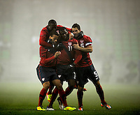 Edson Buddle (m, USA) and Timothy Chandler (l, USA) and Carlos Bocanegra (r, USA) celebrates after the Goal to 1:0, during the friendly match Slovenia against USA at the Stozice Stadium in Ljubljana, Slovenia on November 15th, 2011.